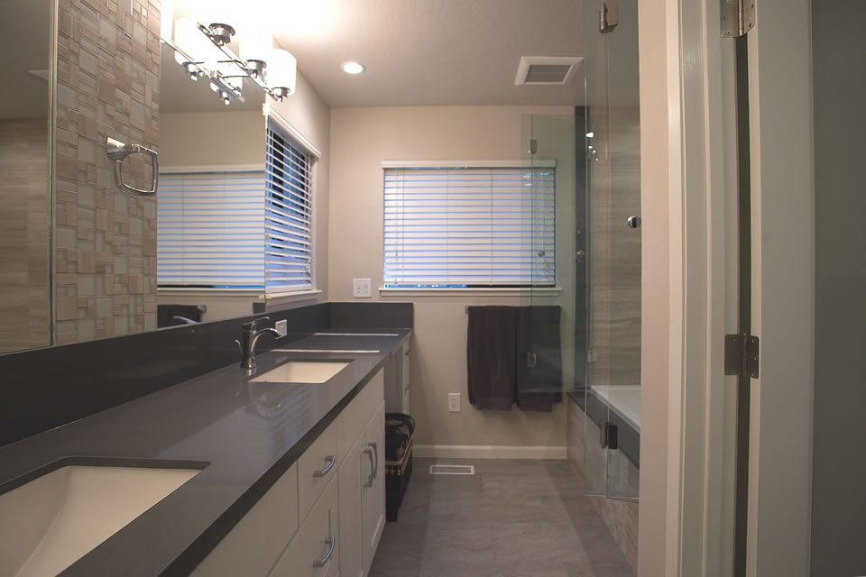 grey counter white cupboard bathroom with tub