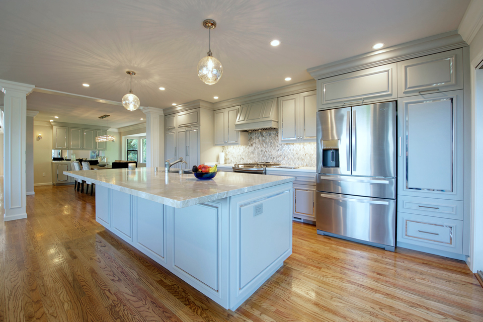 white island kitchen with adjacent semi formal dining