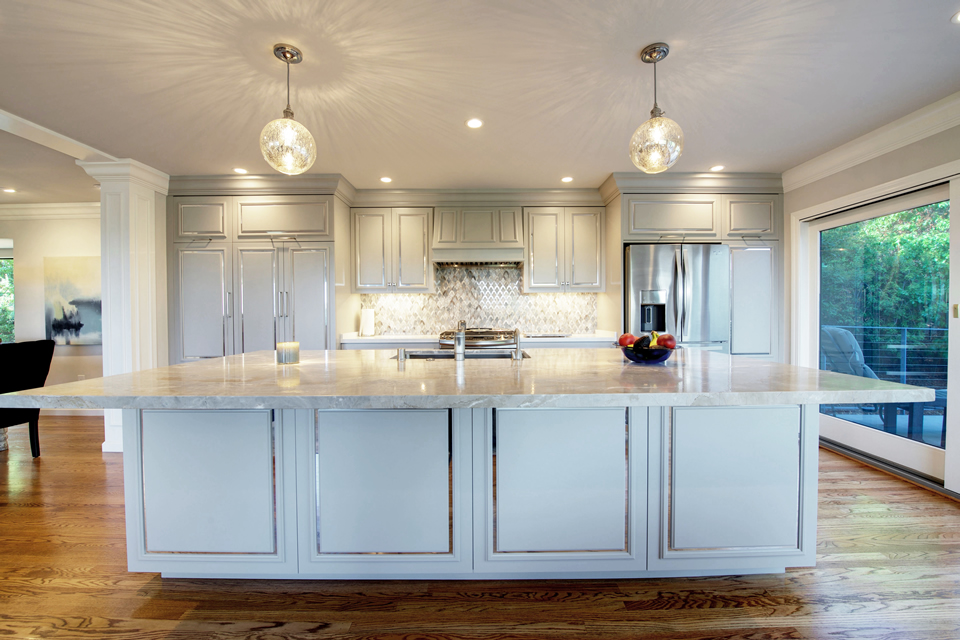 white island kitchen with custom chrome metal trim on doors