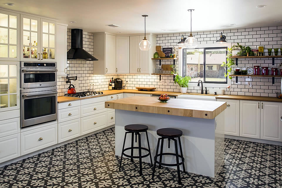 white kitchen with island chopping block counter tops white tile backsplash black and white pattern floor